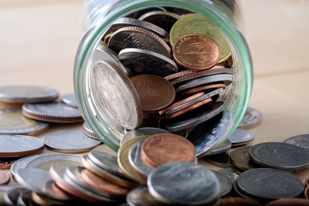 spilling: business finance. save money for investment concept money in the glass