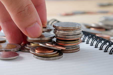 business finance. save money for investment concept  coins baht thai and hand Stock Photo