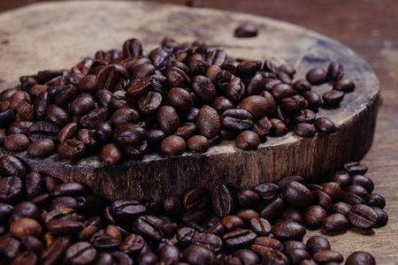 Coffee Bean on wood background with filter effect retro vintage style