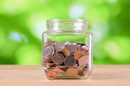 business finance. save money for investment concept money in the glass
