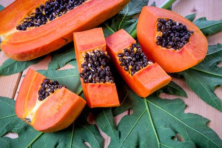 sweet papaya fruit on wooden background. Stock Photo