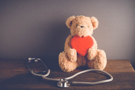 Health Care teddy bear Heart stethoscope with filter effect retro vintage style Imagens