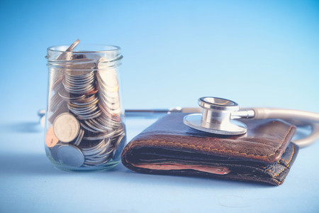 save money for investment concept Stethoscope and money  with filter effect retro vintage style
