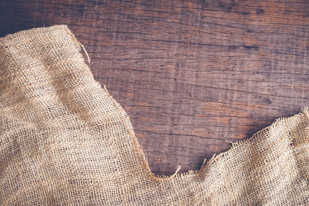 fibrous: Wood table with old sackcloth burlap tablecloth texture with filter effect retro vintage style