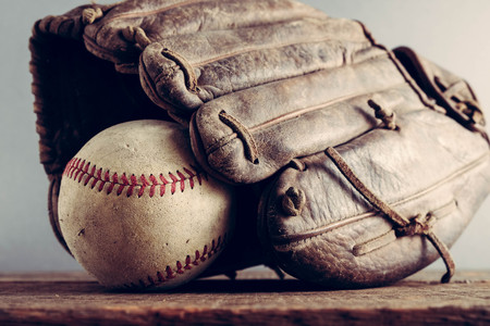 mitt: old Baseball and glove on wood background with filter effect retro vintage style