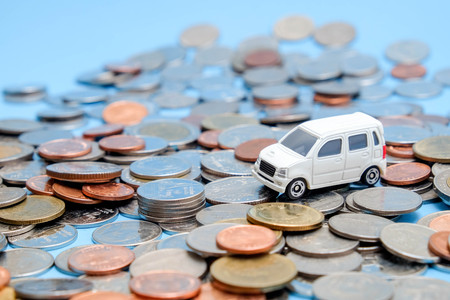 save money for investment concept Toy car and stack of coins