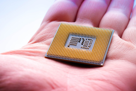 technology cyber electronic concept. cpu microprocessor chip in hand