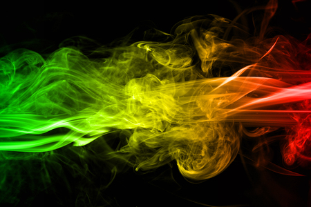 abstract background smoke curves and wave reggae colors green, yellow, red colored in flag of reggae music 写真素材 - 102231430