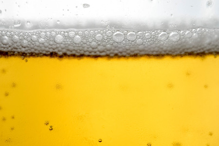 Pouring beer with bubble froth in glass for background Stock Photo - 97595020