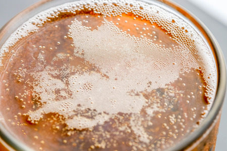 Pouring beer with bubble froth in glass for background Stock Photo - 97595076