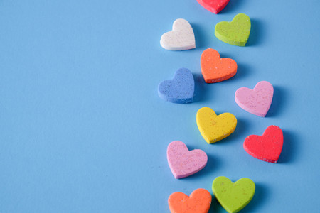 Plain blue background with little heart Stock Photo