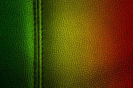 Abstract grunge painted scratched texture background . reggae colors green, yellow, red
