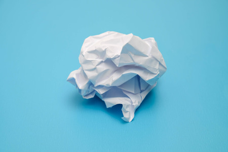 Crumpled paper balls on a blue background