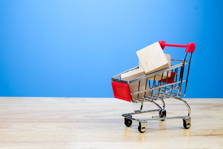 mini shopping cart lover or shopaholic concept Stock Photo