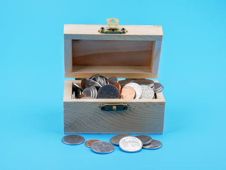 thai coin in the wood chest on blue background