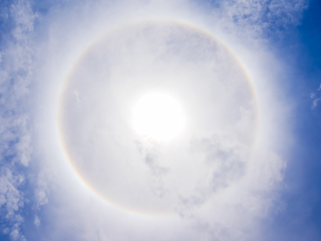 sun halo phenomenon on blue sky