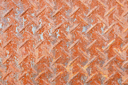 Rusted diamond steel plate background texture