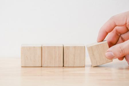 business finance. growing Profit concept,Hand arranging wood block Foto de archivo
