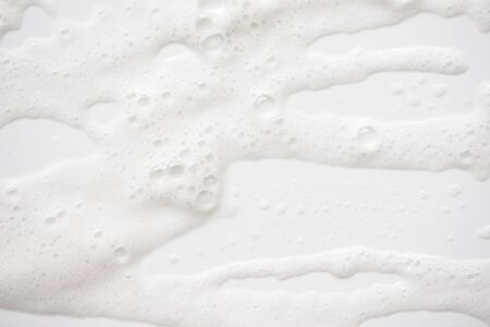 Abstract background white soapy foam texture. Shampoo foam with bubbles Stock Photo
