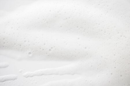 Abstract background white soapy foam texture. Shampoo foam with bubbles Standard-Bild