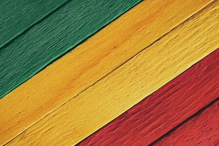 Background wood green, yellow, red old retro vintage style, rasta reggae flag Banque d'images