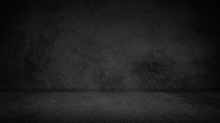 Cement floor background on studio room and spot light.Between darkness