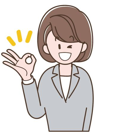 A woman in a gray suit doing OK sign