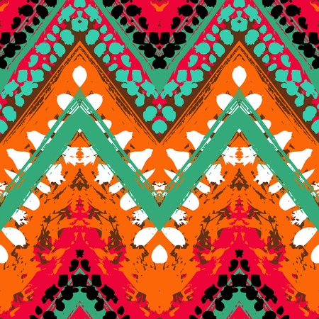 boho: Striped hand painted vector seamless pattern with ethnic and tribal motifs, zigzag lines, brushstrokes and splatters of paint in multiple bright colors for summer fall fashion
