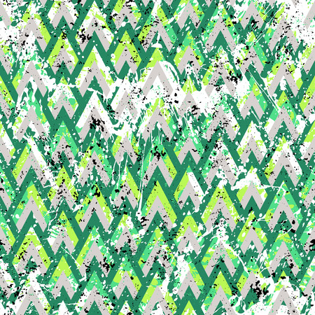 Grunge chevron vector pattern on splashed and splattered watercolor paint. Bold zigzag print with retro motif in vintage boho chic style. Modern geometric texture in green colors