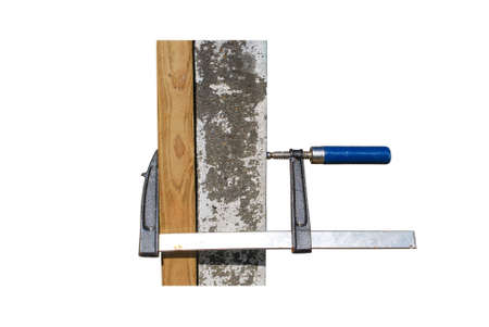 Screw clamps tool press on wood and cement column on white background isolated and clipping path. Object helping and useful tool for crapenter. Stock Photo