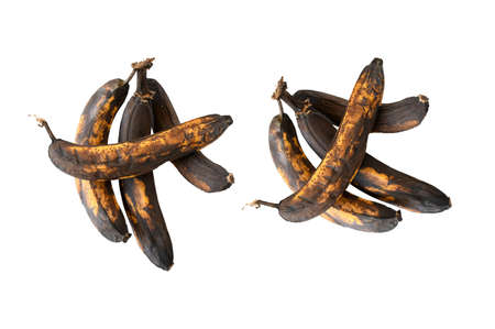 Rotten banana fruit on white background isolated and cliping path Rotten banana with black skin and dark brown and yellow, not fresh .Unhealthy and expired fruite.