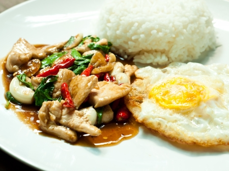 fried basil chicken and fried egg photo