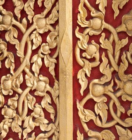 golden lotus pattern on thai temple wall photo