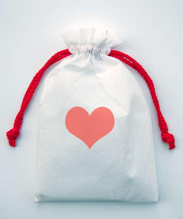 heart gift bag isolated on white background photo