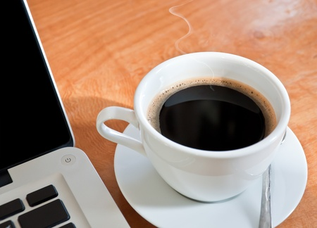 coffee hour: laptop and a cup of coffee