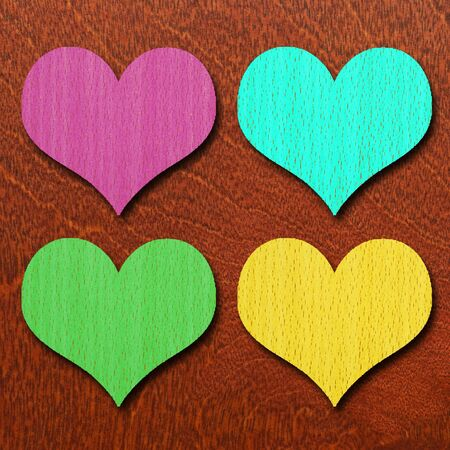 four texture: colorful hearts on wood background, pink blue green and yellow Stock Photo