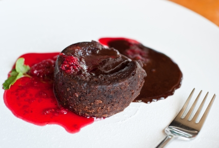 lava cake and strawberry sauce on plate photo