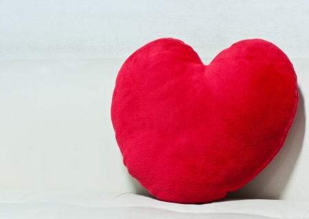 pillow red heart shaped  on white sofa Stock Photo