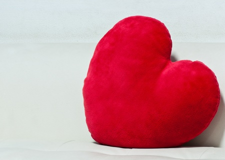 pillow red heart shaped  on white sofa Stock Photo - 12383844