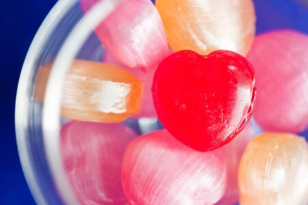 colorful valentines heart candy in the glass photo