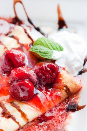 crepes with strawberry jam photo