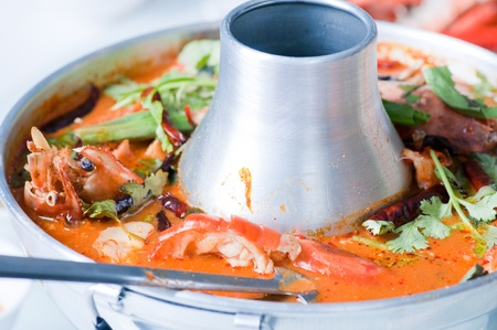 tom yum kung, prawn and lemon grass soup with mushrooms, thai food photo