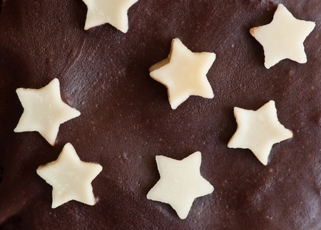 star shaped chocolate on black chocolate background photo