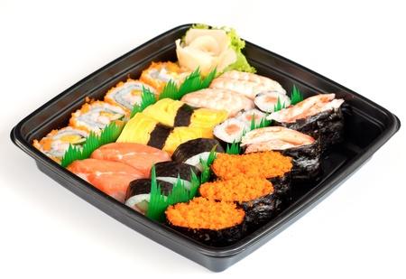 egg roll: sushi set isolated on white
