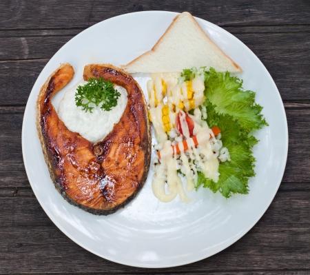 salmon steak on wood table, top view Stock Photo - 13424065