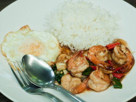 fried shrimp with basil leaves, fried egg and rice Stock Photo - 13549384