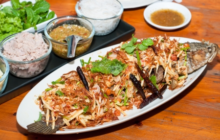 crispy fish salad, thai traditional cuisine photo