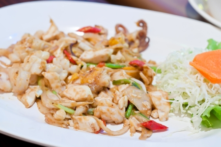 stir fried squid with salted egg yolk, thai fusion food style photo