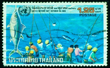 THAILAND - CIRCA 1983: a stamp printed by Thailand, shows people fishing in United Nations Day, circa 1983 photo
