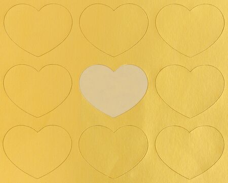 blank heart in the center of gold hearts photo